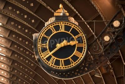 Väggdekor En antik svart och guld järnvägsstation Klocka