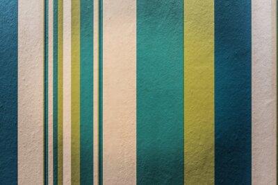 Väggdekor Färgrik vintage bakgrund med randmönster på väggen