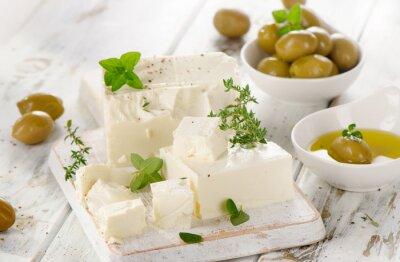 Väggdekor Fetaost med gröna oliver.