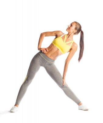 Väggdekor Fitness kvinna gör övningen, leende och tittar upp isolerade på vit bakgrund