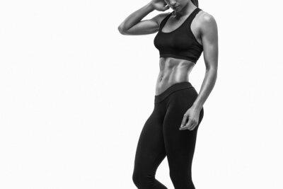 Väggdekor Fitness sportig kvinna visar sin välutbildade kropp