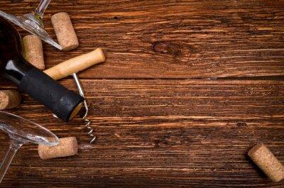 Väggdekor Flaska vin, korkskruv och korkar på träbord. Bakgrund