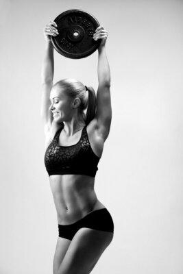 Väggdekor flicka med vikter på stången