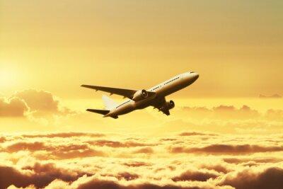 Väggdekor Flygplan på himlen vid solnedgången