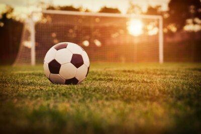 Väggdekor fotboll solnedgång