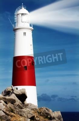 Väggdekor Fyr på klippor med ljusstrålar