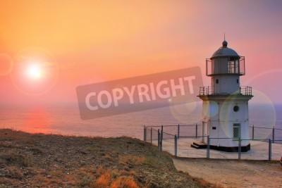 Väggdekor Fyr vid kusten i gryningen