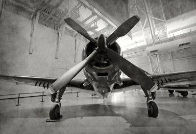 Väggdekor Gamla flygplan i en hangar
