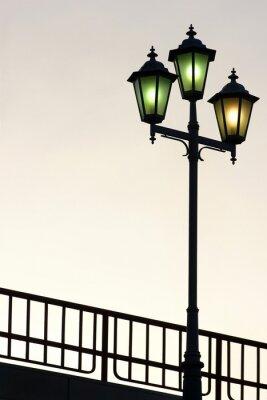 Väggdekor Gammal gata lyktstolpe mot skymning bakgrund