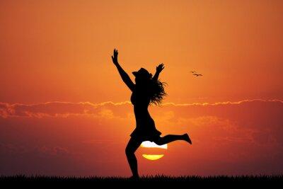 Väggdekor glad tjej vid solnedgången