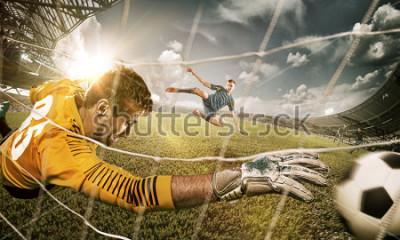 Väggdekor Goalkeeper in gates jumping to catching ball