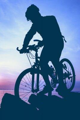 Väggdekor Hälsosam livsstil. Cyklistens silhuett cyklar vid havet.