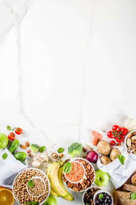 Väggdekor Healthy food. Selection of good carbohydrate sources, high fiber rich food. Low glycemic index diet. Fresh vegetables, fruits, cereals, legumes, nuts, greens.  copy space