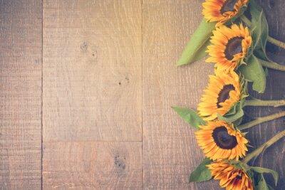 Väggdekor Höstbakgrunds med solrosor. Visa från ovan. Retro filtereffekt