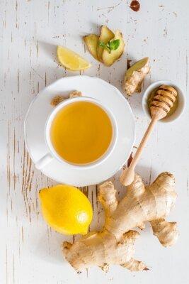 Väggdekor Ingefära te och ingredienser på vit trä bakgrund