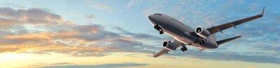Väggdekor Modern passagerare flygplan i solnedgången panorama