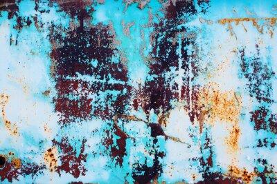 Väggdekor rostig metall med knäckt blå färg. färgad bakgrund av rostig järnytan med en ljus blå färg peeling och sprickbildning konsistens