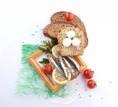 Väggdekor sardiner på skiva bröd