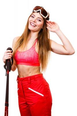 Väggdekor Skierkvinna i googles med skidstavar. vintersport