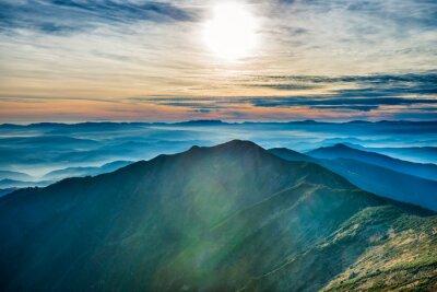 Väggdekor Solnedgång i bergen
