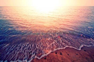 Väggdekor Solnedgången över havet.