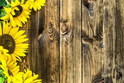 Väggdekor Solrosor på lantlig wood bakgrund. Blommor bakgrunder med copy-space