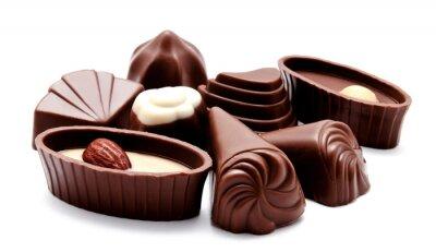 Väggdekor Sortiment av choklad godis isolerade