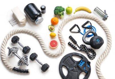 Väggdekor Sportutrustning och sund näring på en vit bakgrund. Toppvy. Motivering