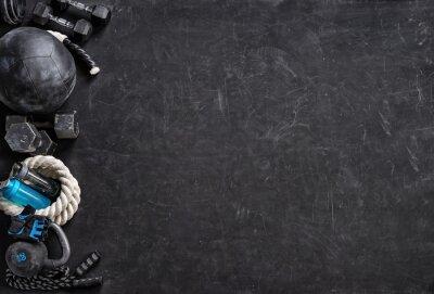 Väggdekor Sportutrustning på en svart bakgrund. Toppvy. Motivering