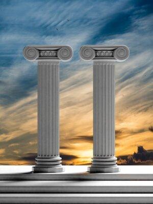 Väggdekor Två antika pelare med solnedgång himmel bakgrund.