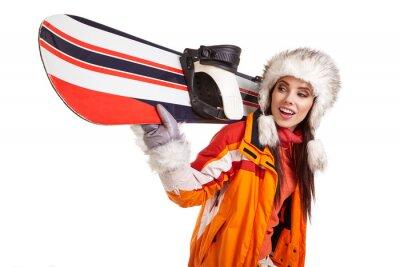 Väggdekor Ung kvinna som står med snowboard isolerad på vitt